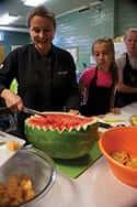 April Hamilton creatively carving a watermelon