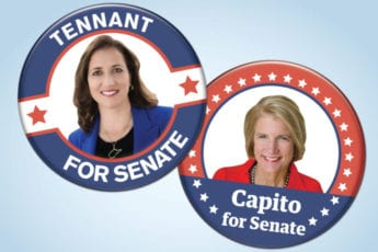 "Two political buttons. One for Natalie Tennant with a photo of here stating ""Tennant for Senate"" and the other with Shelley Moore Capito saying ""Capito for Senate"""