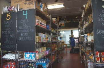 a home brewed grocery store with hand-made signs and stocked shelves