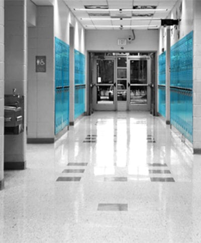 looking down a school hallway lined with blue lockers