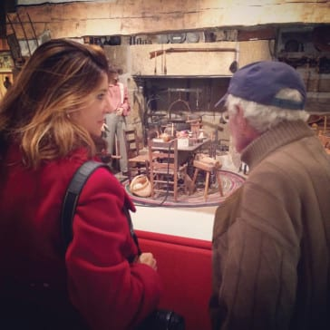 Nikki Bowman and Mike Perry looking at a historic kitchen setting