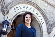 Joyce McConnell poses in front of Stewart Hall at WVU