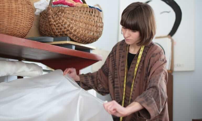 Nellie Rose Davis measuring out silk