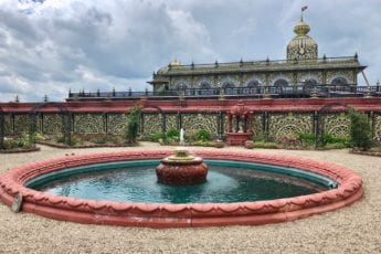 palace of gold with fountain in front
