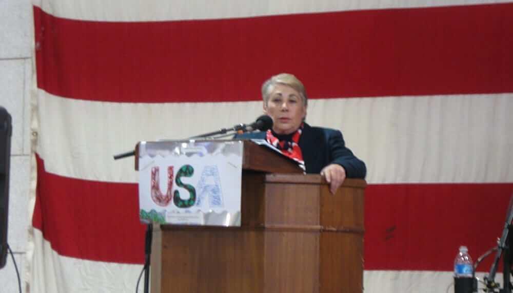 Anne Montague making a speech at a podium