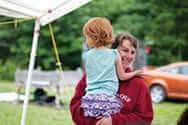 Sarah Riley holding a child