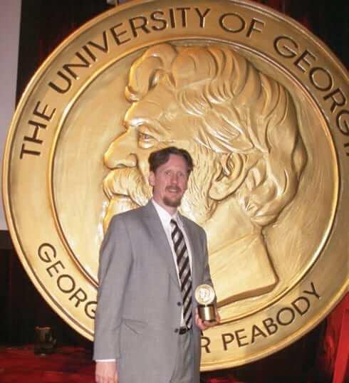 Trey Kay showing his award