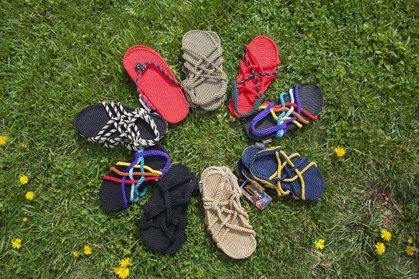 Hand-made sandals displayed in a circle on grass