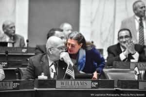 woman legislator discussing with other legislator.
